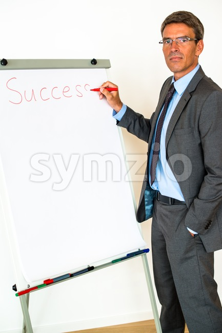 Businessman with Flipchart Stock Photo