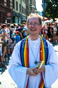 Participant dressed as pastor of Christopher Street Day Stock Photo