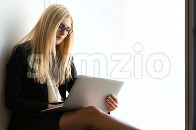 Young pretty business woman with a laptop Stock Photo
