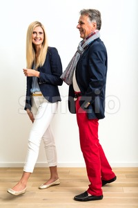 Mature man and young woman flirting Stock Photo