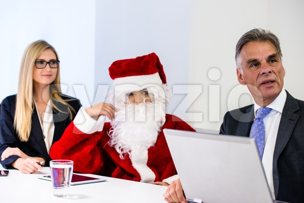 Santa Claus in business meeting Stock Photo