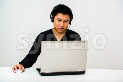 Asian business man with headset Stock Photo