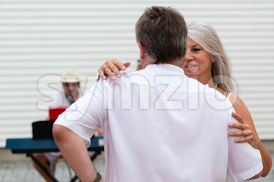 Couple dancing to a solo entertainer Stock Photo