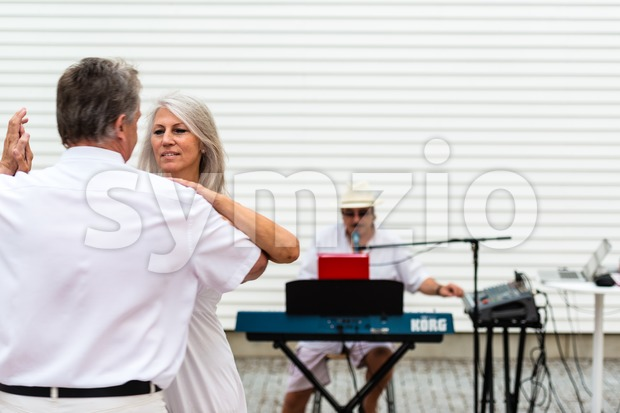 Dancing to a solo entertainer Stock Photo