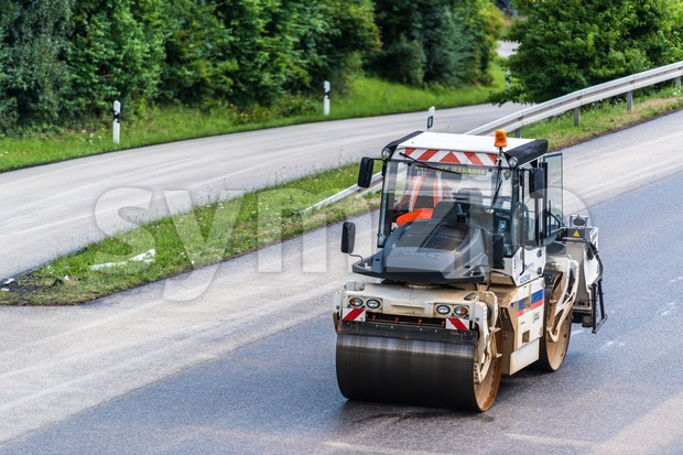 Road roller during asphalt paving works Stock Photo