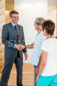 Banker and Senior Couple Stock Photo