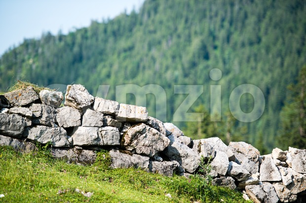 Stone wall in the alps Stock Photo