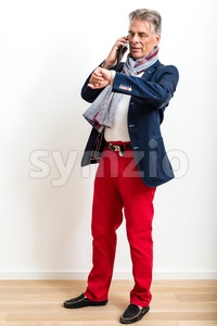 Stylish pensioner using mobile phone Stock Photo