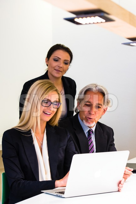 Group in business meeting with laptop Stock Photo