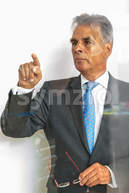 pointing on glass Stock Photo