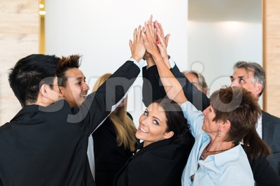 Teamwork - business people with joint hands in the office Stock Photo
