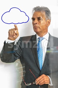 pointing at the cloud on glass Stock Photo