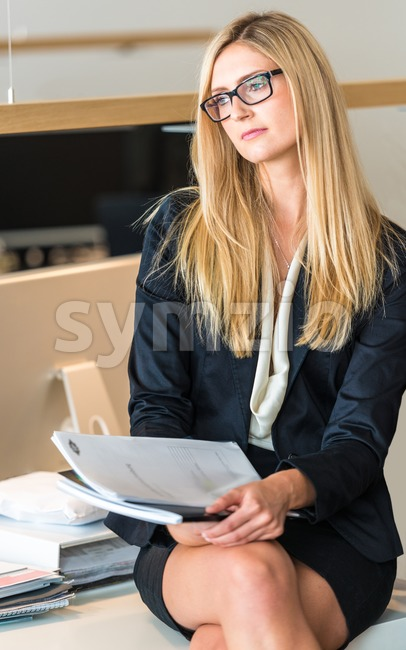 Businesswoman In Office Working On A Document Stock Photo