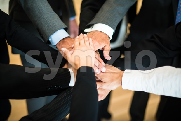 Teamwork - stack of hands Stock Photo