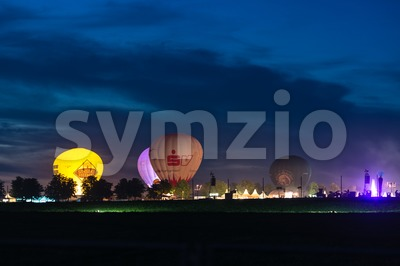 hot air ballons and tents in the evening during a festival Stock Photo