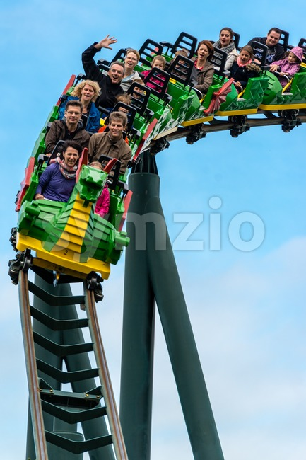 GUENZBURG, GERMANY - SEPTEMBER 21, 2013: People are enjoying a roller coaster ride in Legoland Germany on September 21, 2013 ...