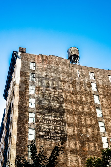 old urban building with list of former brands in new york Stock Photo