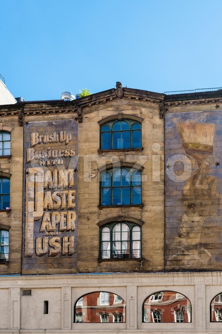 old urban building with advertising for a painters store  in new york Stock Photo