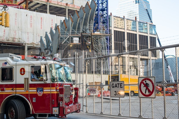 NEW YORK, USA - SEPTEMBER 28, 2013: Fire brigade approaching the entrance to the National 9/11 Memorial with World Trade ...