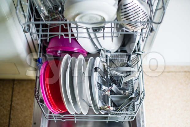 Dishwasher after cleaning process - shallow dof Stock Photo