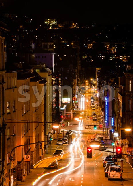 STUTTGART, GERMANY - NOVEMBER 9, 2013: Vivid night scenery showing light traces of cars passing by in long exposure at ...