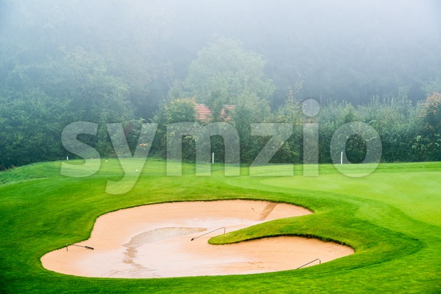 Sand bunker on the golf course. Stock Photo