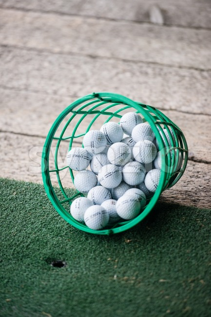 LORCH, GERMANY - OCTOBER 5, 2013: Bucket of branded practice golf balls on the driving range of the golf course ...