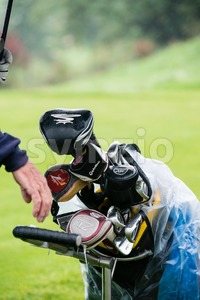 golf club set in carrier bag during rain Stock Photo