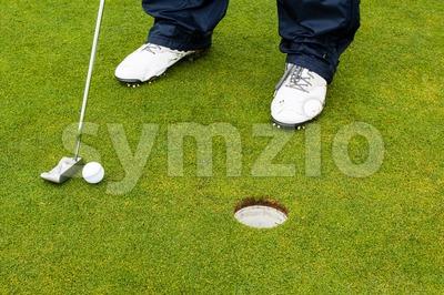 Golf player hitting the ball Stock Photo