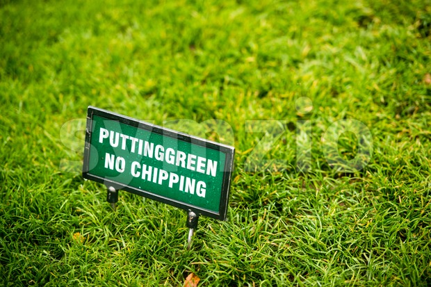 Putting green at the golf course with sign putting green - no chipping