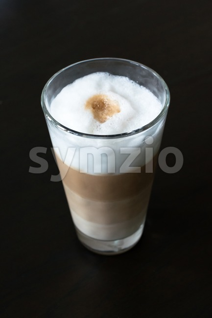 Glass with classic latte coffee Stock Photo