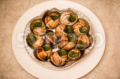 Close up of Escargots with garlic butter Stock Photo