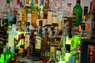 Alcoholic beverages in bottles at a bar. Stock Photo
