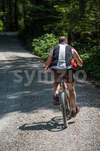 Overweight mountainbiker Stock Photo