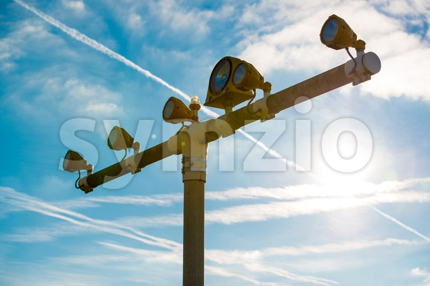 Runway lights at the airport in sunlight Stock Photo