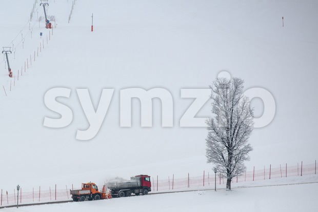 snow thrower and dump truck Stock Photo
