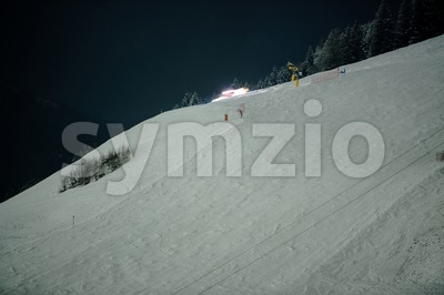 Snow groomer at night Stock Photo