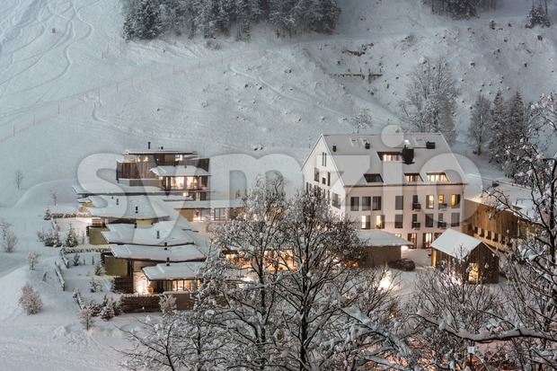 Luxurious ski resort in Austrian Alps in late winter afternoon with fresh snow