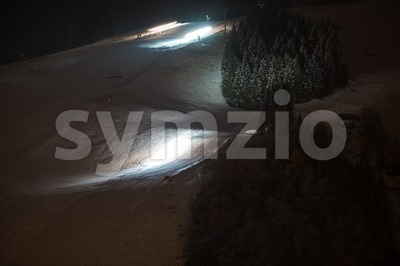 Snow groomers at night Stock Photo