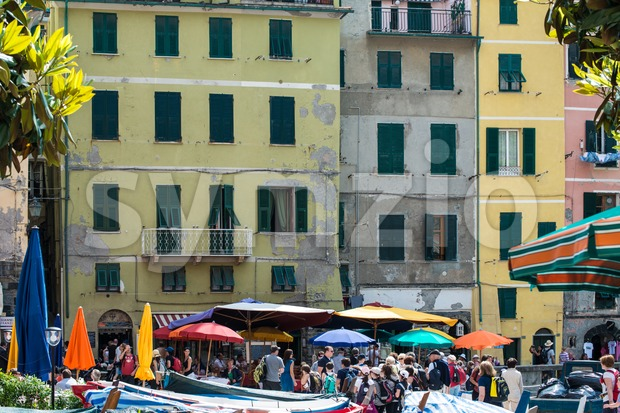 VERNAZZA, ITALY - MAY 22, 2013: Tourists in the beautiful harbor of Vernazza on the afternoon of May 22, 2013 ...