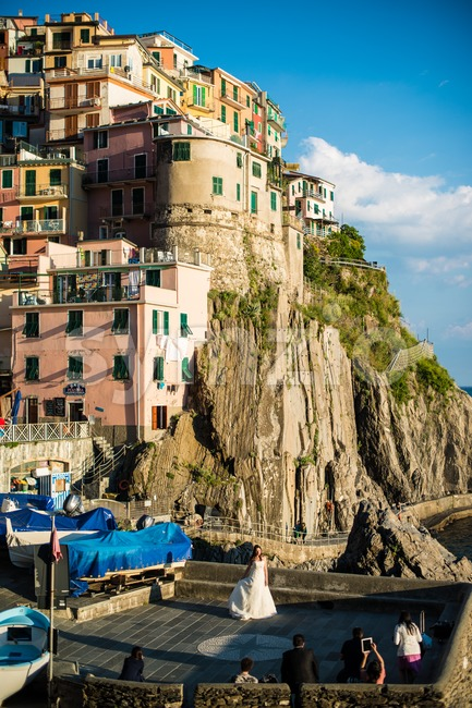 MANAROLA, ITALY - MAY 22, 2013: Wedding photos being taken in the beautiful town and tourist attraction in early evening ...