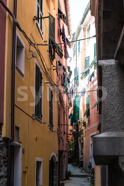 VERNAZZA, ITALY - MAY 22, 2013: A tourist woman in the beautiful small alleys of Vernazza on the afternoon of ...