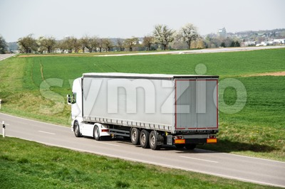 White truck moving on a main road Stock Photo