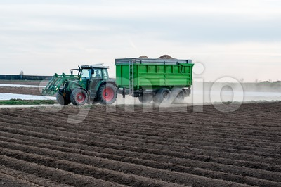 Modern tractor with trailer Stock Photo