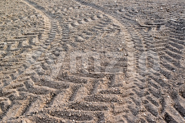 Tractor tracks in field Stock Photo