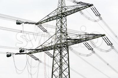 high voltage power pole construction works Stock Photo