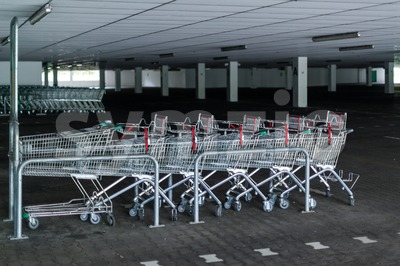 Rows of shopping carts in abandoned car park Stock Photo