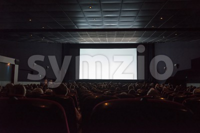 Empty cinema screen with audience Stock Photo