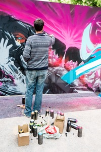 Graffiti artist spraying the wall Stock Photo