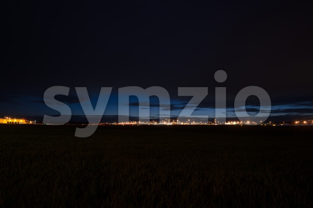 STUTTGART, GERMANY - MAY 6, 2014: Extreme wide angle shot of Stuttgart Airport at dusk with planes departing and arriving ...